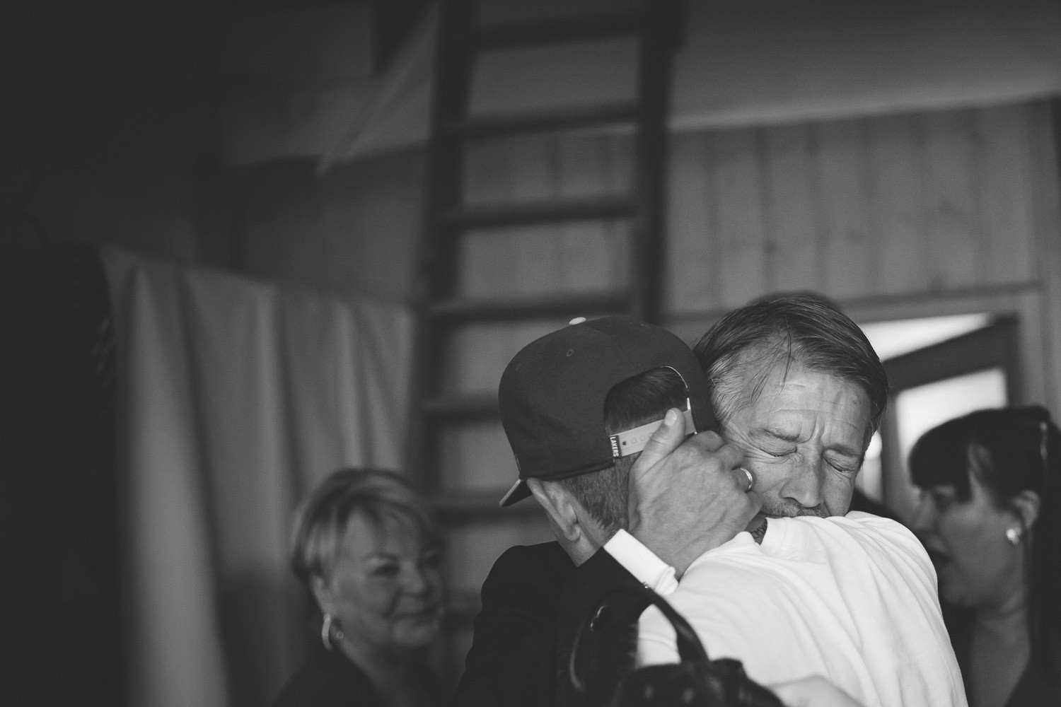 father son wedding embrace